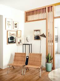 Wooden room divider in a bright contemporary home | NONAGON.style