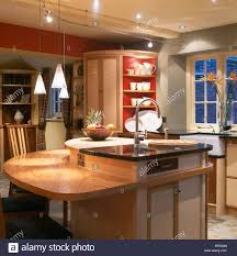 bar pendant lighting. Pendant Lighting Above Breakfast Bar On Island Unit With Integral Sink In Modern Kitchen