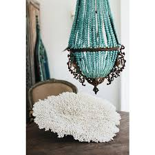 bbc boracay says light and bright chandelier in romantic turquoise we have one similar in shape but made with small puka ss from boracay island