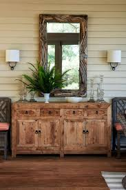 lake cabin furniture. A Driftwood Mirror By Local Artist Paul Allen And An Indonesian Buffet Anchor One Side Of Lake Cabin Furniture N