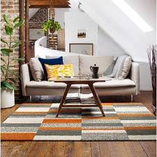 gray and orange stripes rug