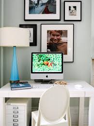 creating a home office. small home office with white desk and table lamp creating a g