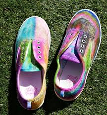 allow the shoes to dry completely once the shoes are dry add glitter spray or metallic paint to replicate stars these are my son s non galaxy shoes