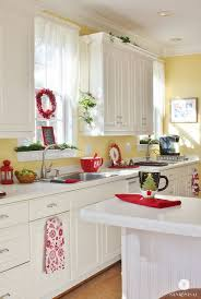 cream white kitchen cabinets paired with soft yellow walls