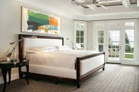 rug on carpet bedroom. Rug On Beige Carpet Bedroom Traditional With Colorful Artwork White Coffered Ceiling Padded Headboard