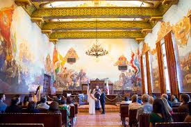 the bride and groom the bride and groom getting married at the santa barbara courthouse mural room