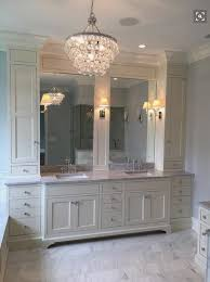 Ivory Master Bathroom Features A Robert Abbey Bling Chandelier Illuminating Ivory Cabinets Topped With Gray Marble Fitted With His And Hers Sinks Under