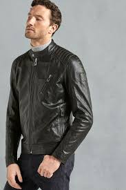 so called due to its links to motorcycle racing the racer is on the more minimal end of the leather jacket style spectrum featuring a stand collar