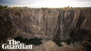 It is located on the border. Victoria Falls Dries To A Trickle After Worst Drought In A Century Zimbabwe The Guardian