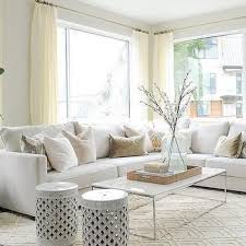 white rug living room. beautiful living room features a white sectional lined with pale pink velvet pillows as well yellow and gray ikat in bansuri fabric paired rug t