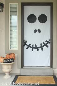 appealing archives design ideas with white and black color door feat colorful pumpkin
