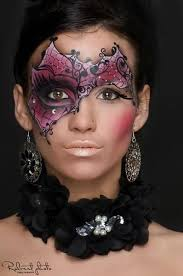 creative purple and black crystal accented masquerade make up mask face painting
