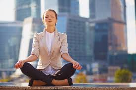 meditation office. business woman meditating outside in front of her office stock photo meditation