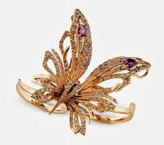 the erfly from damiani uses yellow gold accented by brown and white diamonds and amethysts each erfly is made with a variety of material