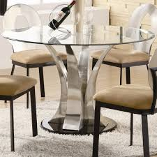 unique glossy round glass top dining room table and four cushioned chairs on white fluffy area