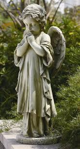 angel garden statue. young praying angel garden statue