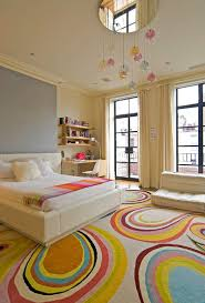 ... Contemporary kids' bedroom inside New York home with fashionable rug  [From: McQuin Partnership