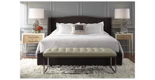 upholstered velvet wingback bed with nailhead trim