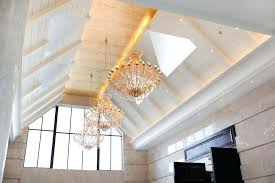 hanging pendant lights on vaulted ceiling luxury room with tall ceiling and chandeliers