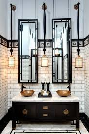 the tall mirrors long pendants and tile emphasize the height of this bathroom vanity barnwood mirror oyster pendant lights