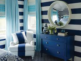 They ran Ralph Lauren's blue-and-white striped wallpaper horizontally to  add more punch