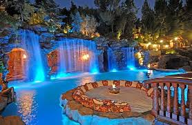 Outdoors Luxury Backyard Pool With High Pool Waterfall And Huge
