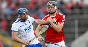 cork s mark coleman with colin dunford of waterford in action during the munster shc round