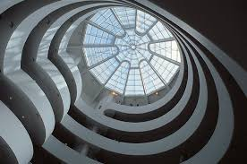 the spiral ramp of the guggenheim museum and the glass dome above it