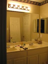 inspiring bathroom design with lowes bathroom lighting plus white cabinets  and double sink with silver faucet