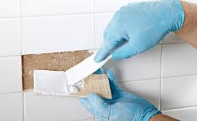 applying tile adhesive