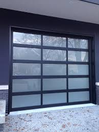 oversized aluminum glass garage door in custom home in oakville by windowsanddoorstoronto ca