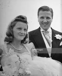 henry ford ii. henry ford ii r and his new wife smiling after their wedding ceremony ii o