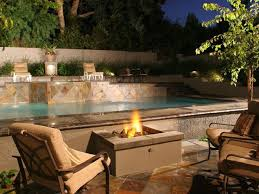 gas fire pit by pool