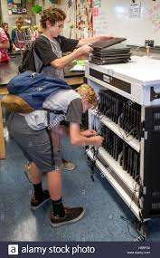 Image result for CHROMEBOOKS CHARGING AT A SCHOOL