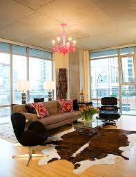 baroque cowhide rugs in living room industrial with cowhide rug next to brown sofa alongside male bedroom decorating and chocolate brown couch