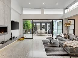 i love how the old meets the new with the white painted floorboards then the polished concrete floor the living e is light and really fresh and open