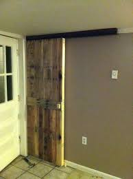 white sliding barn door from reclaimed pallet wood with ceiling mount hardware and mounted track duplex s specialty doors