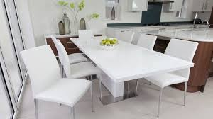 comfortable white dining chairs and white gloss extending dining table