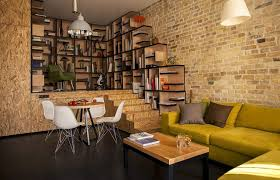vintage exposed brick wall living room interior decor showing l shape lime green sofa also amazing open wall shelves also round dining table complete white