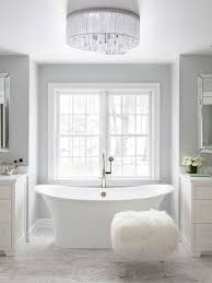 stunning white and gray bathroom featuring gray walls
