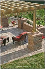 Pergola idea for patio. Love the stones around the support beams!
