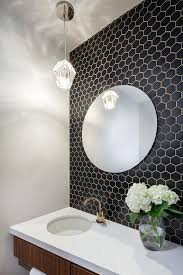 small black hex tiles on the bathroom wall with white grout