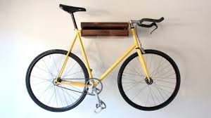 Wall bicycle mount Storage Cant Decide Whether To Use That Blank Piece Of Wall For Shelf Or Bike Mount Now You Can Have Both With The Bike Shelf Small Wallmounted Shelf With Coolthingscom Meet The Bike Shelf Shelf Rack With Bike Mount Carved In