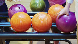 How Much Does A Bowling Ball Weigh