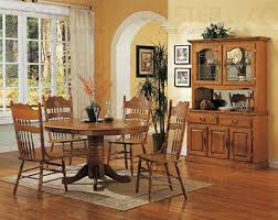 nostalgia 5 piece 48 inch round oval dining set with post press back chairs in light oak finish by coaster 5279nnn
