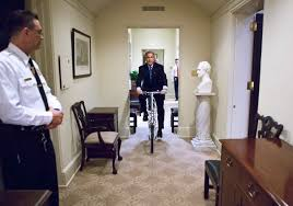 bush oval office. Bush Goes For A Ride Through The Oval Office After Opening Bike Sent As Gift From Prime Minister Of Singapore. And Secret Service Tries To Keep