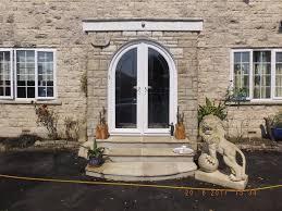 white pvc u french doors with bespoke glass