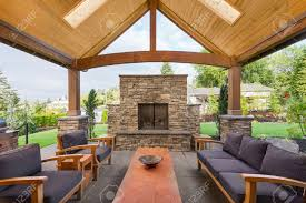 Backyard Covered Patio covered patio outside luxury home with large stone fireplace 6527 by guidejewelry.us
