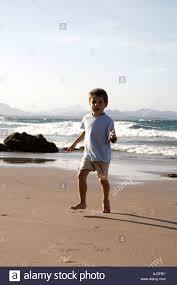 Young boy child walking on Little Wategos Beach Cape Byron near Byron Stock  Photo - Alamy