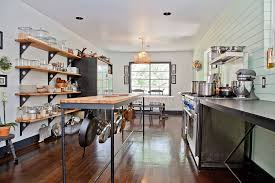 open shelves and kitchen island provide ample storage space in this elegant kitchen design chic shabby french style distressed white